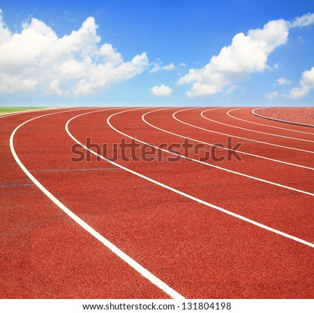Running track with lanes over sky and clouds - stock photo