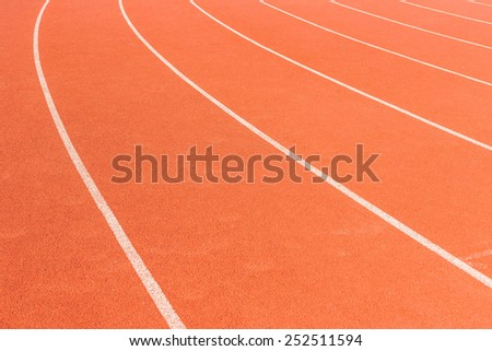 Running track with white stripe for athletics - stock photo
