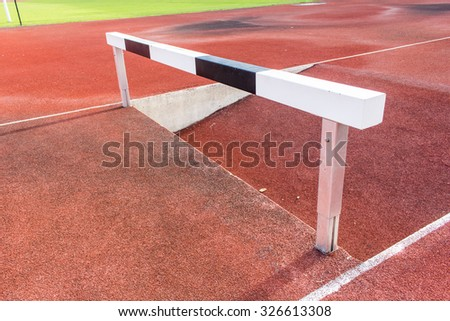 Running tracks and hurdles - stock photo