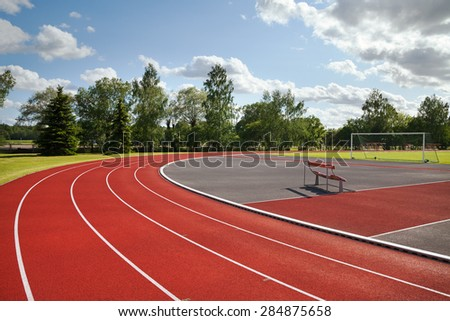 Running tracks on the athletics stadium. - stock photo