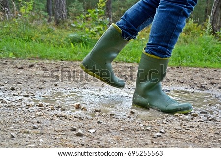 Running with boots through a puddle