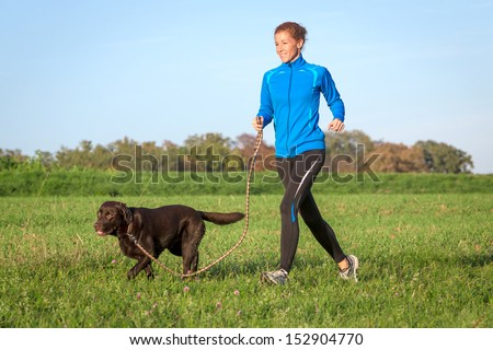 running with dog - stock photo