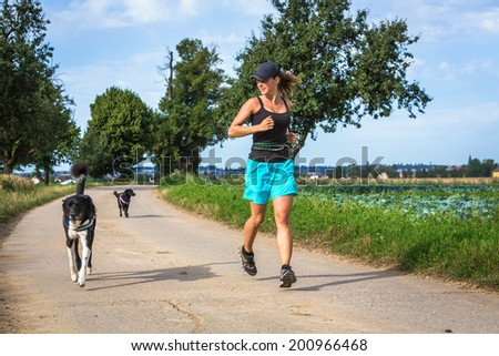 running with dogs - stock photo