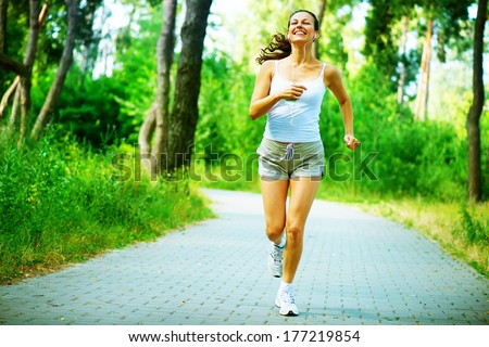 Running woman. Female Runner Jogging during Outdoor Workout in a Park. Beautiful fit Girl. Fitness model outdoors. Weight Loss. Healthy lifestyle. Morning