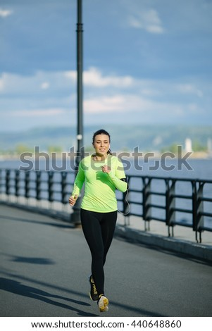 Running woman. Female Runner Jogging during Outdoor Workout in a Park. Beautiful fit Girl. Fitness model outdoors. Weight Loss - stock photo