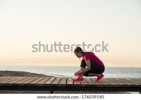 Running woman. Female runner jogging during outdoor workout on beach. - stock photo