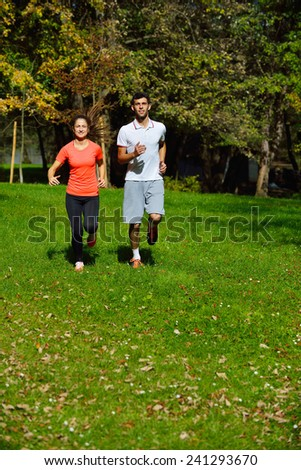 Running woman. Female runner jogging during outdoor workout Youn - stock photo