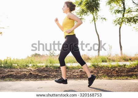 Running woman. Female runner jogging during the sunrise
