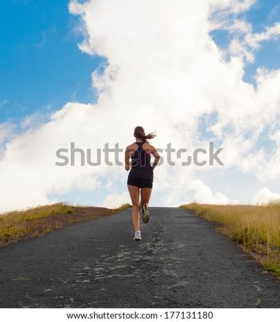 Running woman. Female runner jogging outdoor. - stock photo