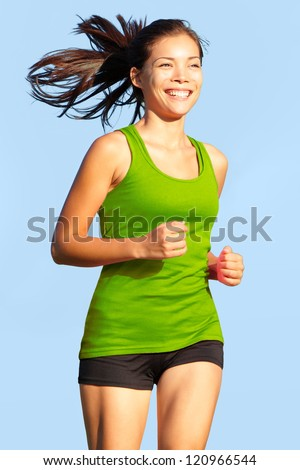 Running woman. Happy, young and athletic female fitness model in sports wear jogging outside. - stock photo