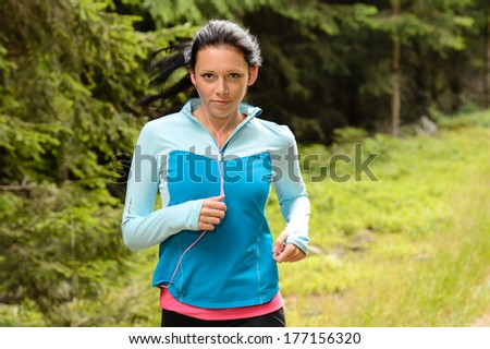 Running woman in forest fitness training outdoor - stock photo