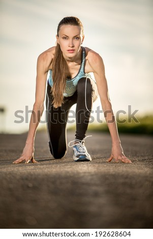 Running woman. Young woman jogging outdoors on auto road. Sport woman starting running. backlight - stock photo