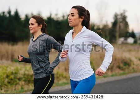 Running Women Jogging in Country - stock photo
