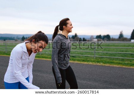 Running Women walking and laughing in Country - stock photo