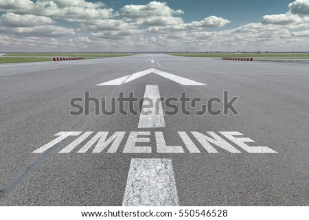 Runway of airport with arrow guideline and timeline letters painted on the surface