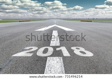 Runway of airport with arrow guideline and year 2018  letters painted on the ground