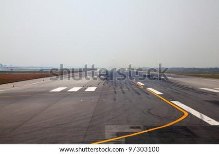 Runway of the Bangkok international airport - stock photo