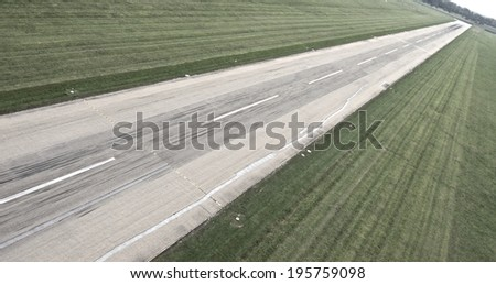 Runway to Infinity Sideway aerial from a runway at St. Gallen Airport in Switzerland - stock photo