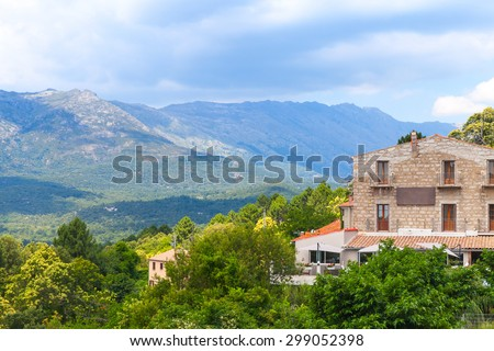 Rural Corsican landscape, old stone houses and mountains on the horizon. Zonza, Corsica, France