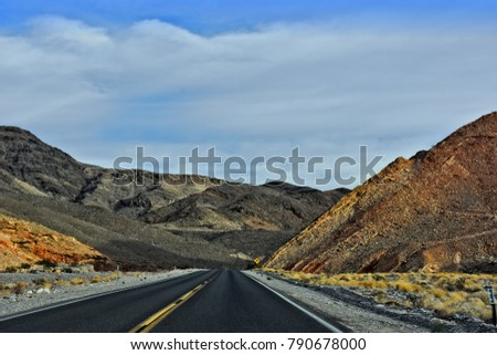Rural desert road in Death Valley National Park. California. USA.