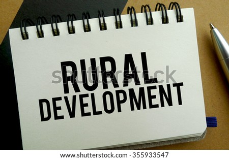 Rural development memo written on a notebook with pen