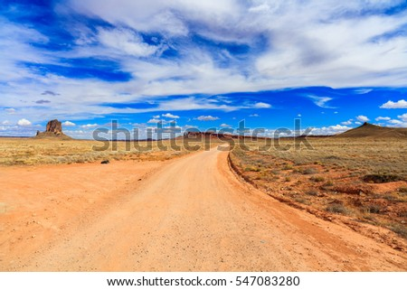 Rural dirt road in the Arizona desert.