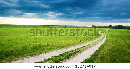 Rural dirt road in the filed landscape