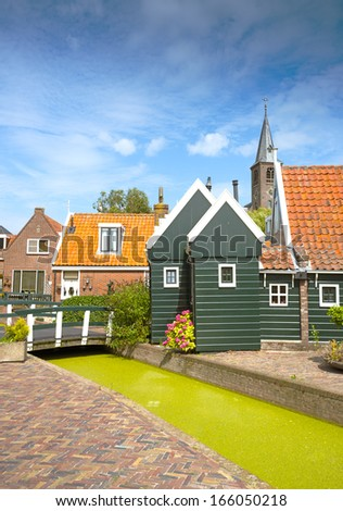 rural dutch scenery of small old houses - stock photo