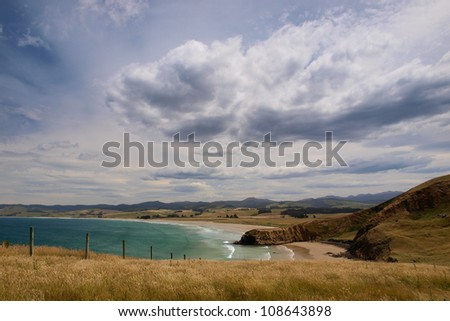 Rural farmland along rugged New Zealand coast - stock photo