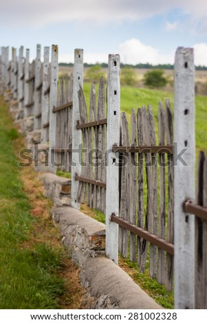 Rural fence detail. - stock photo