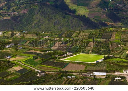 Rural hillside landscape with small farms, orchards and a pitch along the road between Ambato and Banos in Tungurahua Province in Central Ecuador - stock photo