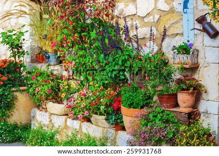 Rural house decorated with flowers in pots, Gourdon France - stock photo