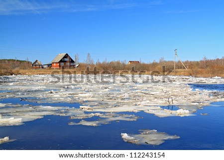 rural house on river coast - stock photo