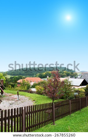 Rural house summer day in Eastern Europe. - stock photo