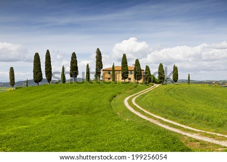 Rural house with cypress trees around, Tuscany, Italy - stock photo