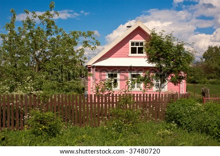 Rural house with the garden and fence. Very typical cottage found in the villages all over Russia, Ukraine and Belarus.