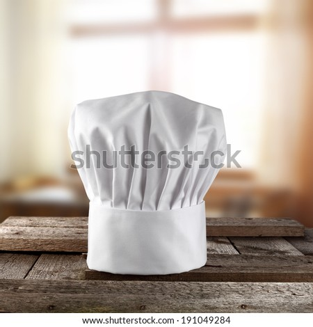 rural kitchen and cook hat  - stock photo
