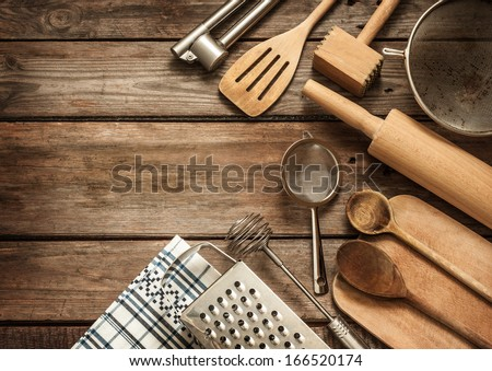 Rural Kitchen Utensils On Vintage Planked Wood Table From Above