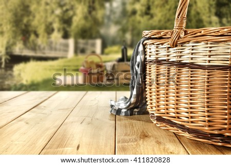 rural landscape and blue napkin brown basket and yellow wooden desk and free place for your food  - stock photo