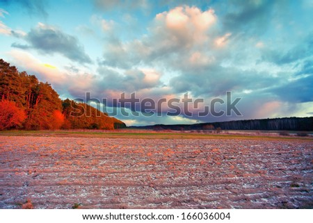 Rural landscape at sunset - stock photo