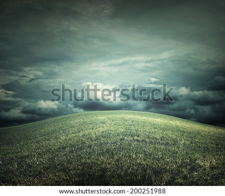 Rural landscape before thunderstorm - stock photo