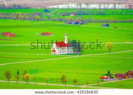 Rural landscape in Bavaria with church St. Coloman, green land in springtime, Germany - stock photo