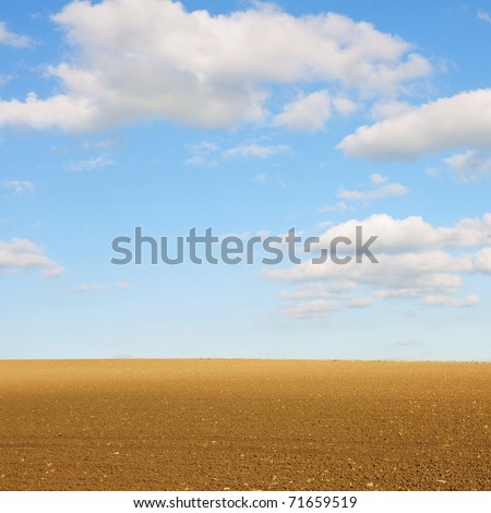 Rural Landscape of Bare Farmland with a Beautiful Sky Above - stock photo