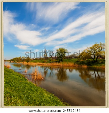 rural landscape, river and vegetation, the spring season - stock photo