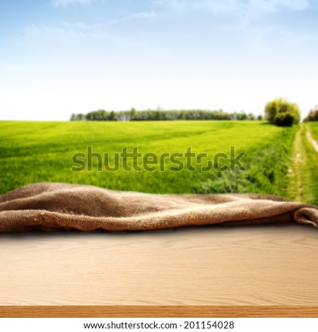 rural landscape with blue sky and desk of furniture  - stock photo