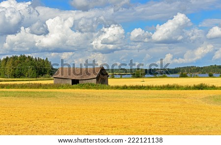 Rural landscape with field and barn. Aland Islands, Finland - stock photo