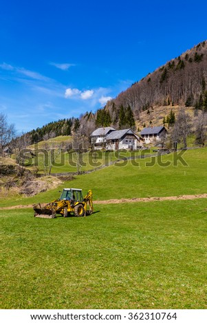 Rural Landscape With Field, Forest, Barn And Tractor-Slovenia,Europe