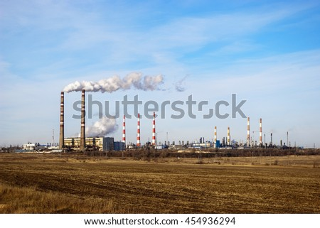 Rural landscape with industry on the horizon - stock photo