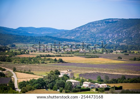 Rural landscape with lavender fields and mountains in Provence, France - stock photo