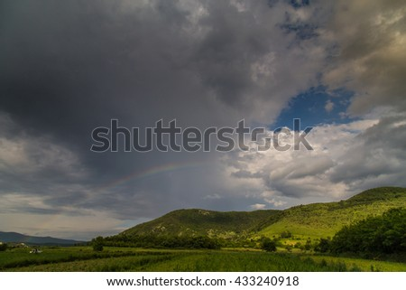 Rural landscape with storm clouds, in summer